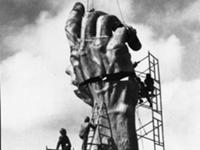 Treister said the arm represents his portrayal of a scene from hell, frozen in bronze. A giant outstretched arm, marked with a Nazi prisoner's tattoo, rises from the earth; the final reaching out of a dying person. The hand, almost in place. Miami Beach,