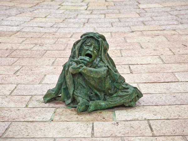 <strong>A Series of Vignettes</strong>  At the end of the Lonely Path, bronze figures express the mixed emotions of terror and compassion. This particular sculpture is of a small child reaching out for help, showing that even the youngest victims faced un