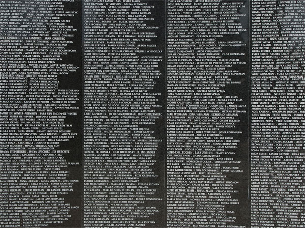 <strong>The Memorial Wall</strong> Not unlike the Vietnam Memorial, this Holocaust Memorial Wall serves many of the survivors and their families as the only real link with their loved ones, a place where families can see the names of a loved one carved in