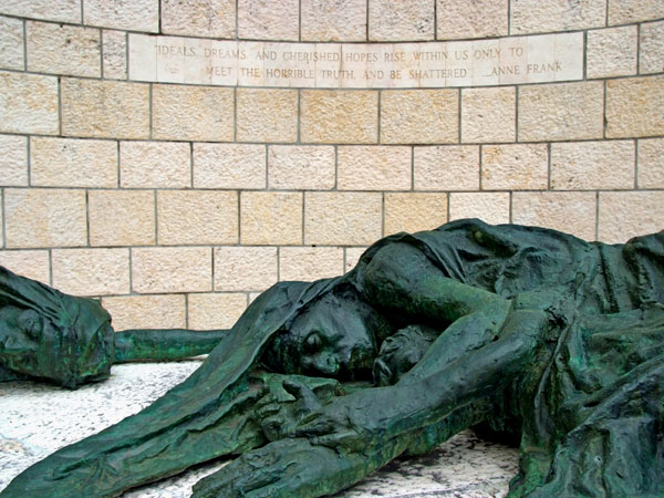 """<strong>The Final Sculpture</strong> The final sculpture depicts the same mother and two children who started the journey, now dead, framed by the words of Anne Frank: """"Ideals, dreams and cherished hopes rise within us only to meet the horrible truths and"""